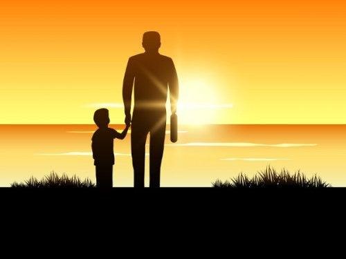 far og søn ser på solnedgang