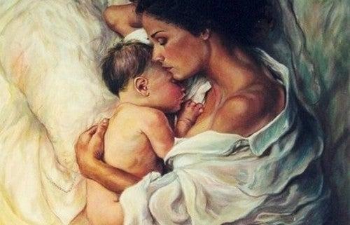 mor og baby sover sammen