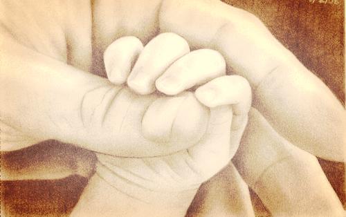 baby holder forælders finger