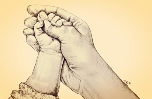 Når din babys lille hånd tager fat om din finger