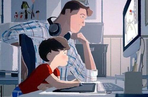 far og søn spiller computer sammen