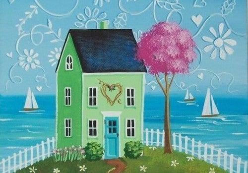 et grønt hus ved havet