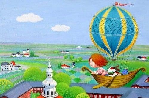 lille pige flyver i luftballon